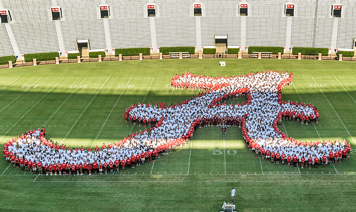 Freshman class standing in the shape of the Script A